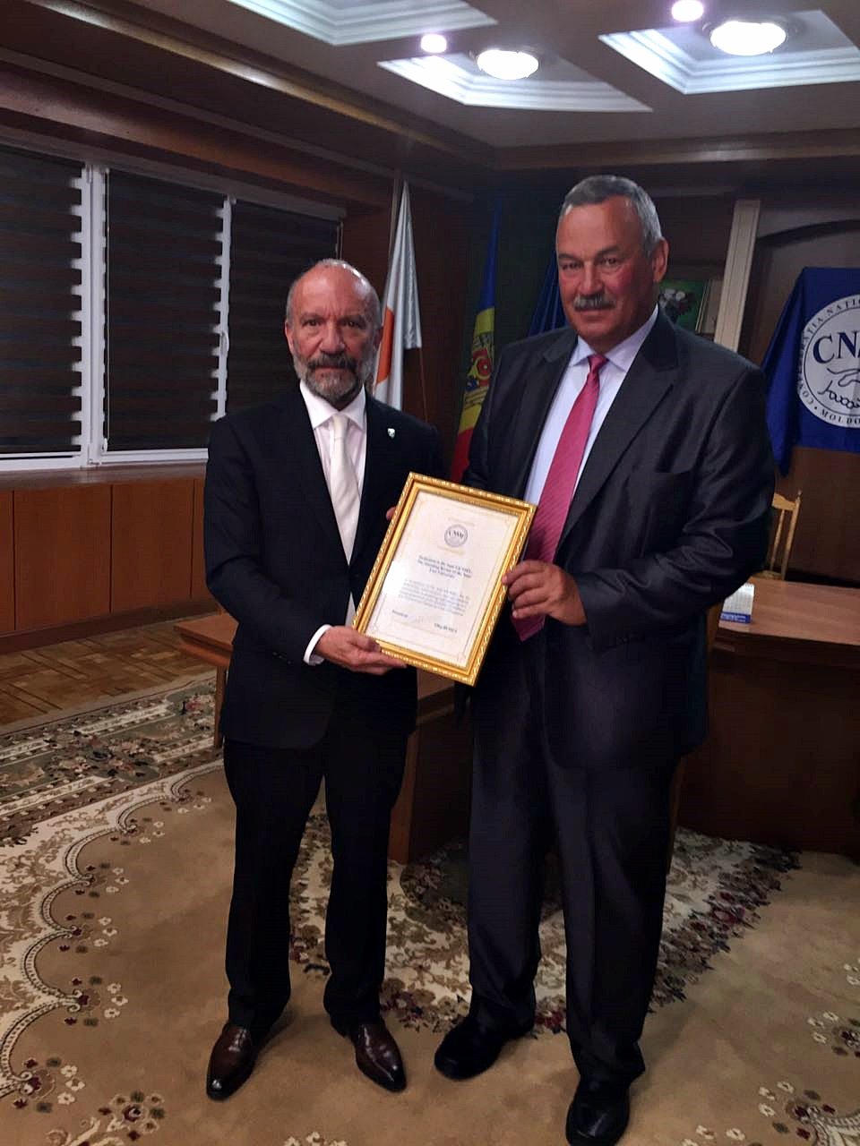 Oleg Budza, President of the National Confederation of Trade Unions of Moldova, presented the Certificate of High Honor to Dr. Suat İ. Günsel