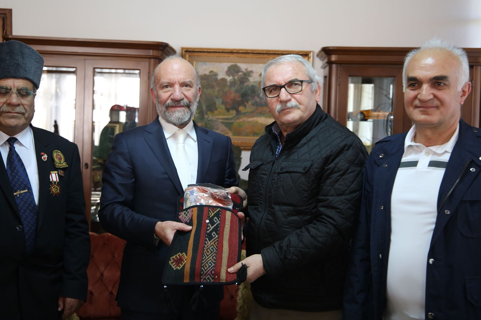 Near East University Founding Rector Dr. Suat İ. Günsel welcomes a Delegation from Sivas Municipality and Sivas Martyrs' Families and Veterans Association in his office
